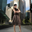 图库照片: Asian Chinese Office lady posing in front of office