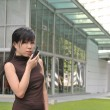 Asian Chinese Girl using a walkie talkie — Stok fotoğraf
