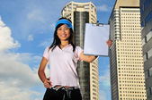 Asian Chinese Lady holding clipboard — Stock Photo