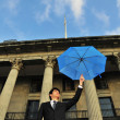 Conceptual pic of Asian Man with an umbrella — Stock Photo