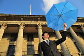 Conceptual pic of Asian Man with an umbrella — Stock Photo