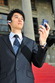 Asian Chinese Man with his telecommunication devices — Stock Photo