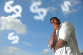 Indian man thinking of how to make money — Stock Photo