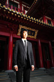 Asian Young Man standing in front of a temple — Stock Photo
