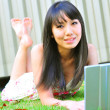Asian chinese lady with her laptop outdoors — Stock Photo #6539197