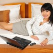 Stock Photo: Beautiful chinese office lady working in her hotel room