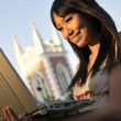Asian Chinese Girl using laptop in the outdoor evening sun — Stock Photo