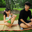 Two siblings outdoor having a picnic — Stock Photo