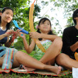 3 children having fun during picnic — Stockfoto