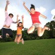 Three children having fun outdoors — 图库照片