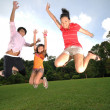 Three children having fun outdoors — ストック写真