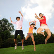 图库照片: Three children having fun outdoors