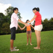 Three children having fun outdoors — Stockfoto