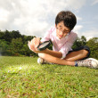 Young boy playing in the gardens outdoor — Stock Photo