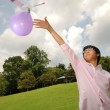Young asian boy playing outdoor with science experiment — Stock Photo