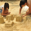 Asian chinese girls playing in the sand — Stock Photo #6542747