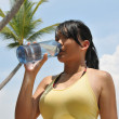 Asian Chinese Girl under the hot weather — Stock Photo
