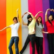 Four asian girlfriends in various poses — Stock Photo