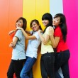 Stock Photo: Four asian girlfriends in various poses