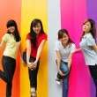 Four asian girlfriends in various poses — Stock Photo #6543441