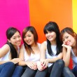 Four asian chinese girls in various poses — Stock Photo