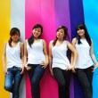 Stock Photo: Four asian chinese girls in various poses