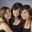 Group of 3 asian chinese girls in various poses — Stock Photo