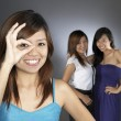 3 teengage asian chinese girls in various poses — Stock Photo