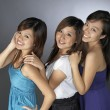 3 teengage asian chinese girls in various poses — Stock Photo #6549404