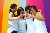 Four chinese asian girls having a great time outdoors — Стоковое фото