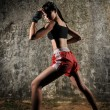 AsiChinese Thai Girl in various Muay Thai Sports pose — Stock Photo #6571839