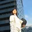Stock Photo: Asichinese fencer in corporate setting