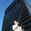 Asian chinese female fencer in the city — Stock Photo #6571892