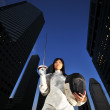 Asian chinese female fencer in the city — Stock Photo #6571906