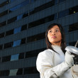 Asian chinese female fencer in the city — Stock Photo #6571926
