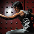 Asian Chinese Man in various martial arts fighting poses - Stock Photo