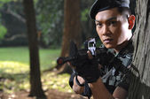 Picture of asian chinese soldier in various scenarios — Stock Photo