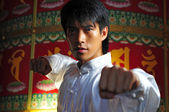 Asian Chinese Man in Kungfu staces — Stock Photo