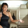 Rich asian chinese woman in the backseat of her car — Stock Photo #6663205