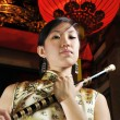 Asian chinese woman holding a flute — Stock Photo
