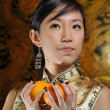 Asian chinese lady with oranges for chinese new year — Stock Photo