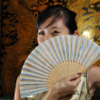 Stock Photo: Asian chinese lady with a fan in her hand