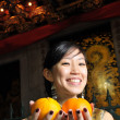 Asian chinese lady with oranges for chinese new year — Stock Photo #6663522