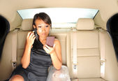 Asian chinese lady in her car putting on her make-up — Stock Photo