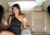 Rich asian chinese woman in the backseat of her car — Stock Photo