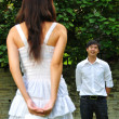 Asian Chinese couple in courtship outdoors — Stock Photo
