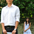 Asian Chinese couple in courtship outdoors - Stock Photo