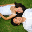 Royalty-Free Stock Photo: Asian chinese couple lying on the grass with various expressions