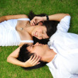 Asichinese couple lying on grass with various expressions — Stock Photo #6718459