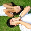 Asichinese couple lying on grass with various expressions — Stock Photo #6718475